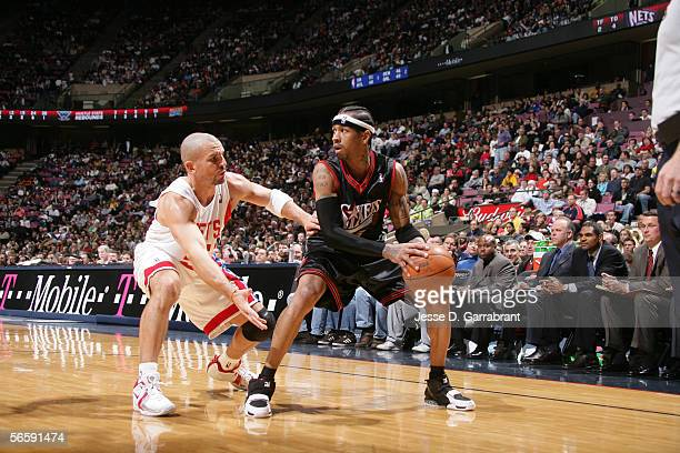 Allen Iverson of the Philadelphia 76ers looks to move the ball against Jason Kidd of the New Jersey Nets at the Continental Airlines Arena on...