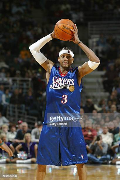 Allen Iverson of the Philadelphia 76ers looks to pass against the Milwaukee Bucks during the game on November 23 2005 at the Bradley Center in...
