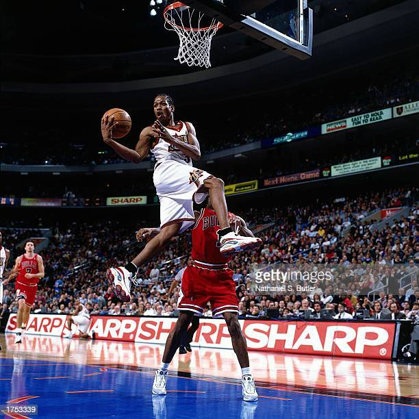 Allen Iverson of the Philadelphia 76ers looks to pass as he drives to the basket against the Chicago Bulls at the First Union Center during the 1998...