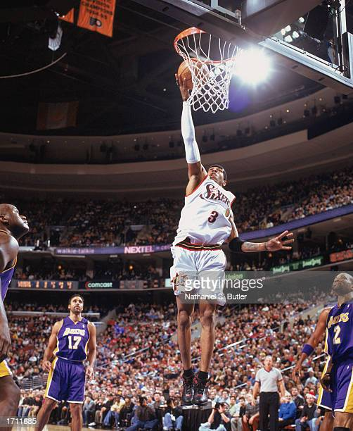 Allen Iverson of the Philadelphia 76ers makes a dunk during the game against the Los Angeles Lakers at First Union Center on December 20 2002 in...