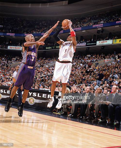 Allen Iverson of the Philadelphia 76ers makes a jump shot against Stephon Marbury of the Phoenix Suns at First Union Center on December 13 2002 in...