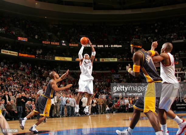 Allen Iverson of the Philadelphia 76ers makes the overtime game winning shot against the defense of the Indiana Pacers on November 12 2004 at the...