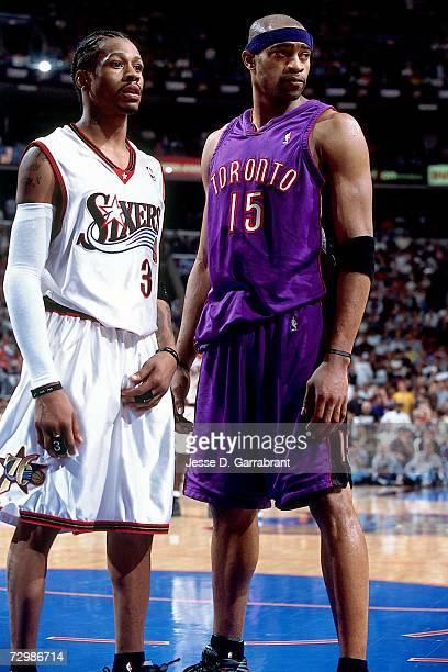 Allen Iverson of the Philadelphia 76ers matches up against Vince Carter of the Toronto Raptors during a 2001 NBA game at the First Union Center in...