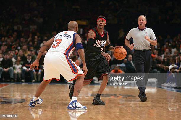 Allen Iverson of the Philadelphia 76ers moves the ball against Stephon Marbury of the New York Knicks during a game at Madison Square Garden on...