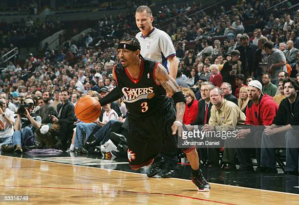 Allen Iverson of the Philadelphia 76ers moves the ball against the Chicago Bulls on January 12 2005 at the United Center in Chicago Illinois The...