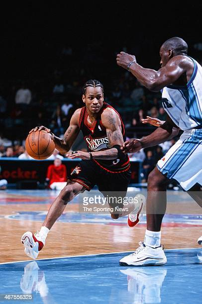 Allen Iverson of the Philadelphia 76ers moves the ball during the game against the Charlotte Hornets on January 20 2000 at Charlotte Coliseum in...