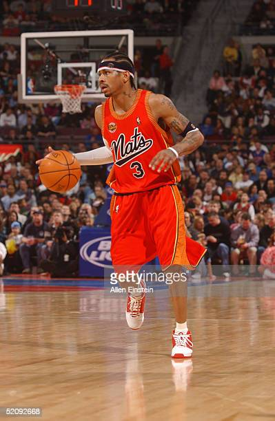 Allen Iverson of the Philadelphia 76ers moves the ball during the game with the Detroit Pistons at The Palace of Auburn Hills on January 15 2004 in...
