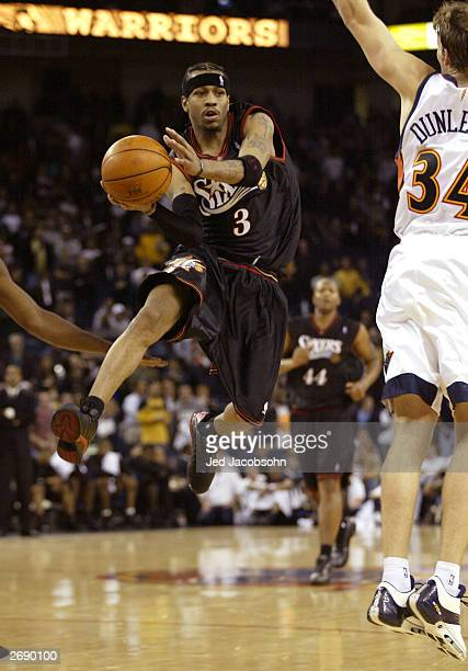 Allen Iverson of the Philadelphia 76ers passes against the Golden State Warriors during an NBA game at the the Arena in Oakland November 1 2003 in...