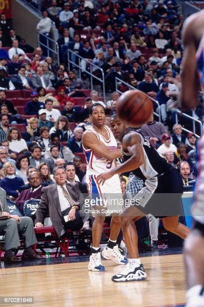 Allen Iverson of the Philadelphia 76ers passes against the San Antonio Spurs circa 1998 at the Spectrum in Philadelphia Pennsylvania NOTE TO USER...