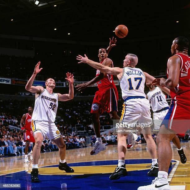 Allen Iverson of the Philadelphia 76ers passes against Todd Fuller and Chris Mullin of the Golden State Warriors on January 3, 1997 at The Arena in...