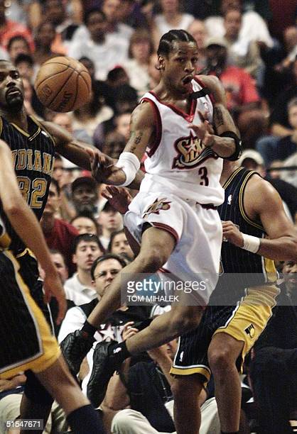 Allen Iverson of the Philadelphia 76ers passes off during first quarter action against the Indiana Pacers in game four of their second round NBA...