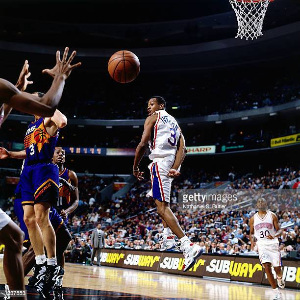 Allen Iverson of the Philadelphia 76ers passes the ball behind his back against the Phoenix Suns in 1997 during an NBA game at the First Union Center...