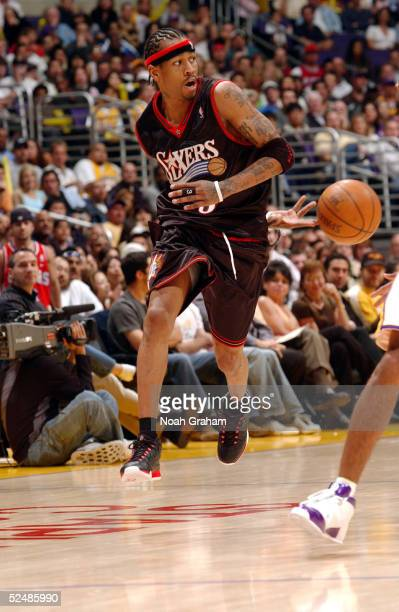 Allen Iverson of the Philadelphia 76ers passes the ball behind his back during a game against the Los Angeles Lakers on March 27 2005 at the Staples...