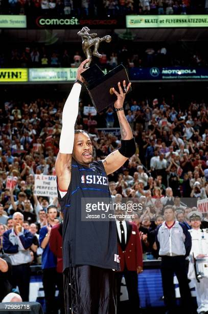 Allen Iverson of the Philadelphia 76ers poses with his league MVP trophy prior to the game against the Toronto Raptors during the Eastern Conference...