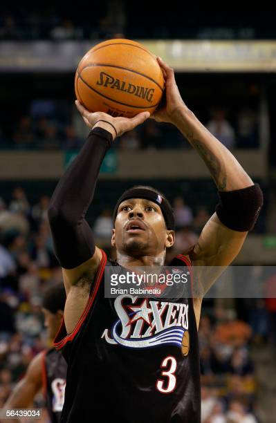 Allen Iverson of the Philadelphia 76ers prepares to shoot a free throw during a game against the Boston Celtics at TD Banknorth Garden on November 30...