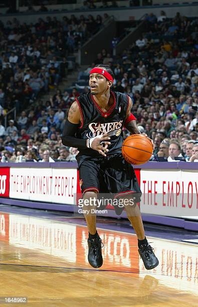 Allen Iverson of the Philadelphia 76ers pulls up for a jump shot during the NBA game against the Milwaukee Bucks at Bradley Center on November 9 2002...
