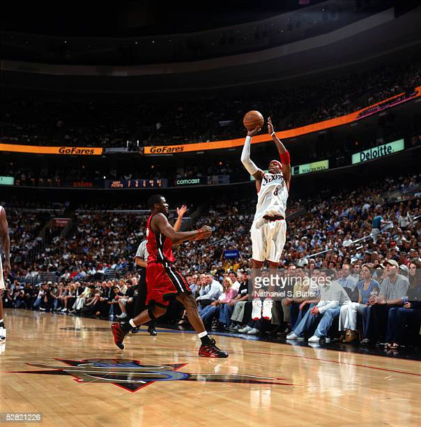 Allen Iverson of the Philadelphia 76ers puts a shot up against Keyon Dooling of the Miami Heat during the game on April 14 2005 at Wachovia Center in...