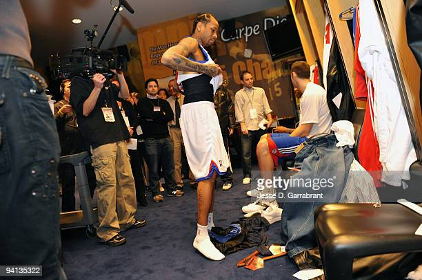 Allen Iverson of the Philadelphia 76ers puts on his new uniform before the game against the Denver Nuggets on December 7 2009 at the Wachovia Center...
