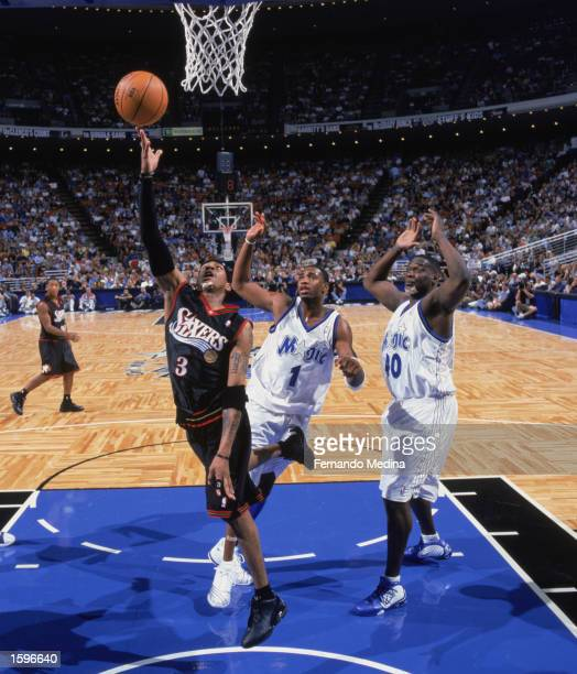 Allen Iverson of the Philadelphia 76ers puts up a shot past Tracy McGrady of the Orlando Magic during the NBA preseason game at TD Waterhouse Centre...