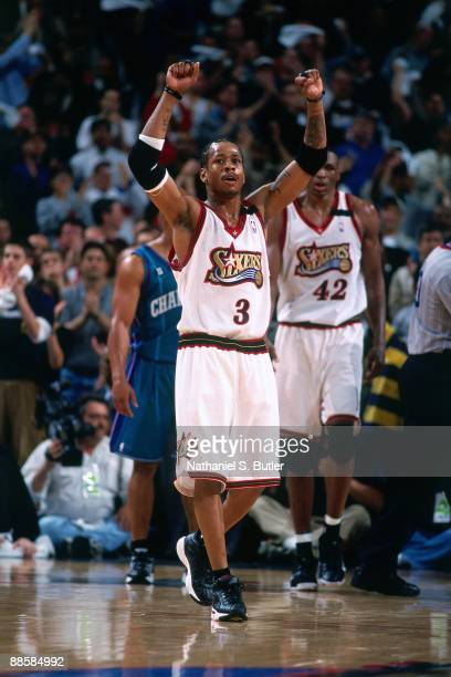 Allen Iverson of the Philadelphia 76ers raises his arms in Game Three of the Eastern Conference Quarterfinals during the 2000 NBA Playoffs at the...