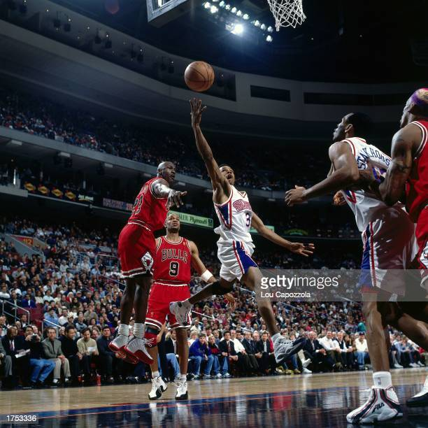 Allen Iverson of the Philadelphia 76ers shoots a driving layup against the Chicago Bulls at the First Union Center during the 1997 NBA season in...
