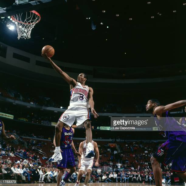 Allen Iverson of the Philadelphia 76ers shoots a driving layup against the Toronto Raptors at the First Union Center during the 1997 NBA season in...