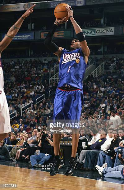 Allen Iverson of the Philadelphia 76ers shoots a jump shot against the Phoenix Suns during the game at America West Arena on January 2 2003 in...