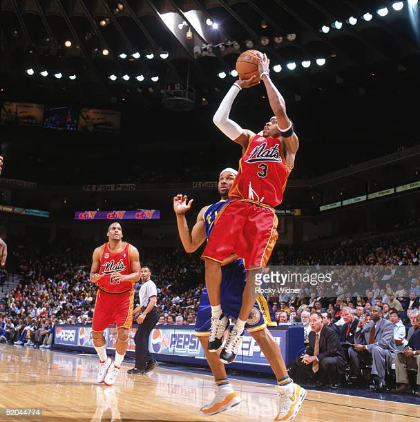 Allen Iverson of the Philadelphia 76ers shoots a jump shot during a game against the Golden State Warriors at The Arena in Oakland on January 3 2005...