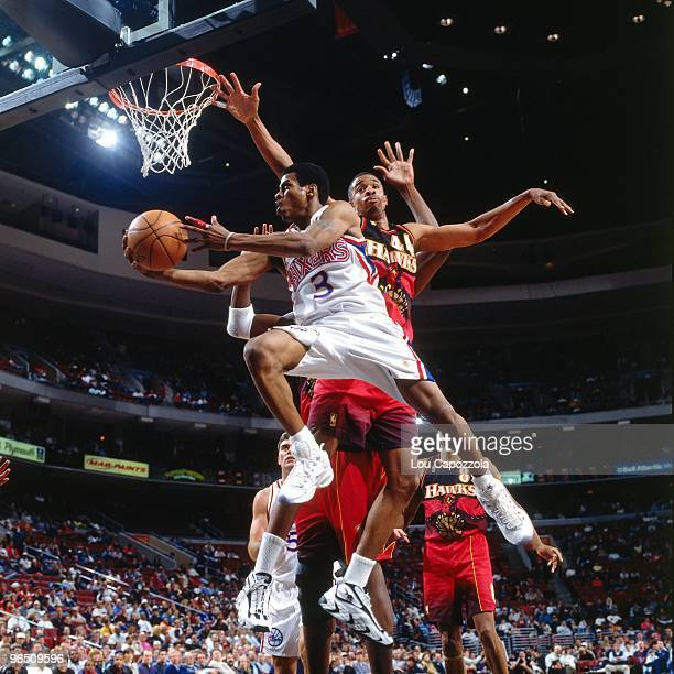 Allen Iverson of the Philadelphia 76ers shoots a layup during a game against the Atlanta Hawks in 1997 at the First Union Center in Philadelphia...