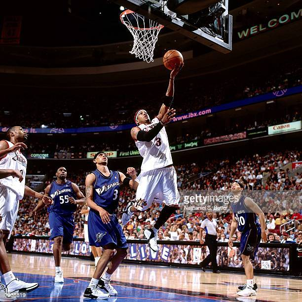 Allen Iverson of the Philadelphia 76ers shoots a layup during the NBA game against the Washington Wizards at First Union Center on March 30 2003 in...