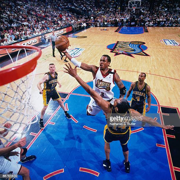 Allen Iverson of the Philadelphia 76ers shoots a layup over Sam Perkins of the Indiana Pacers in Game Four of the Eastern Conference Semifinals...