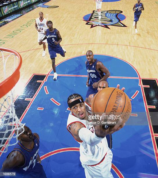 Allen Iverson of the Philadelphia 76ers shoots a reverse layup during the NBA game against the Washington Wizards at First Union Center on November...