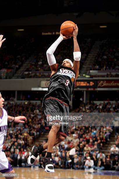 Allen Iverson of the Philadelphia 76ers shoots a running jump shot over Mike Bibby of the Sacramento Kings on January 3 2006 at the ARCO Arena in...