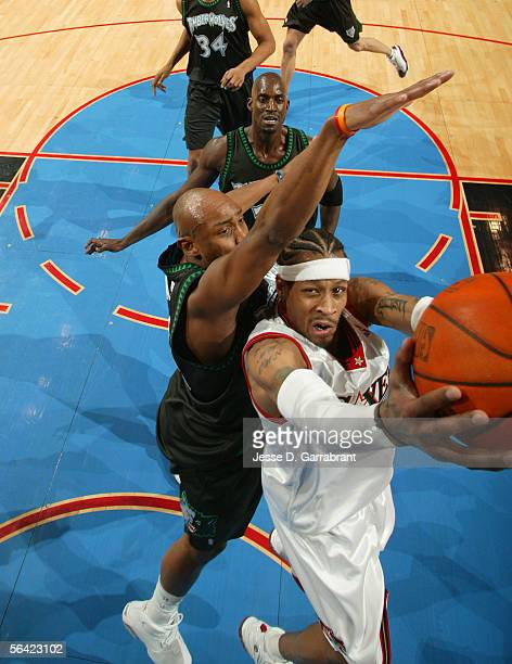 Allen Iverson of the Philadelphia 76ers shoots against Anthony Carter of the Minnesota Timberwolves on December 12 2005 at the Wachovia Center in...