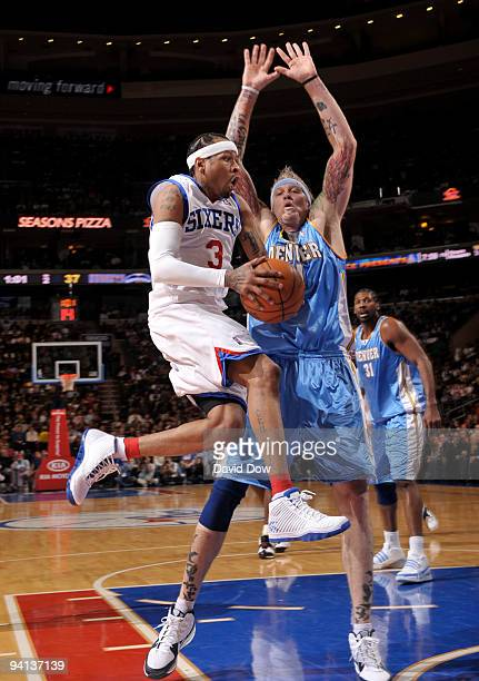 Allen Iverson of the Philadelphia 76ers shoots against Chris Andersen of the Denver Nuggets during the game on December 7 2009 at the Wachovia Center...