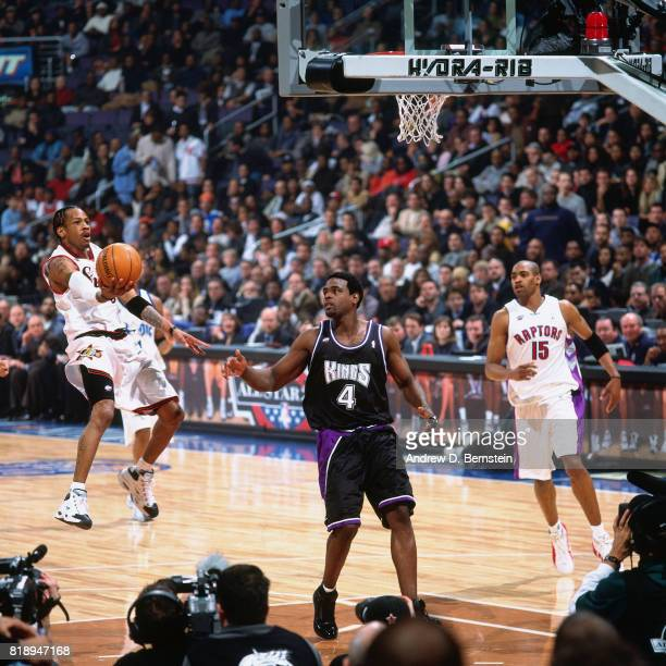 Allen Iverson of the Philadelphia 76ers shoots against Chris Webber of the Sacramento Kings during the NBA AllStar Game at MCI Center in Washington...