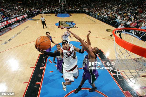 Allen Iverson of the Philadelphia 76ers shoots against Jamaal Magloire of the Milwaukee Bucks on December 7 2005 at the Wachovia Center in...