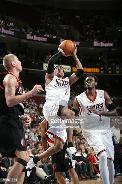 Allen Iverson of the Philadelphia 76ers shoots against Joel Przybilla of the Portland Trail Blazers on November 29 2005 at the Wachovia Center in...
