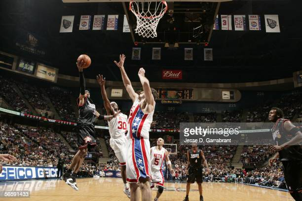 Allen Iverson of the Philadelphia 76ers shoots against New Jersey Nets Clifford Robinson and Nenad Krstic at the Continental Airlines Arena on...
