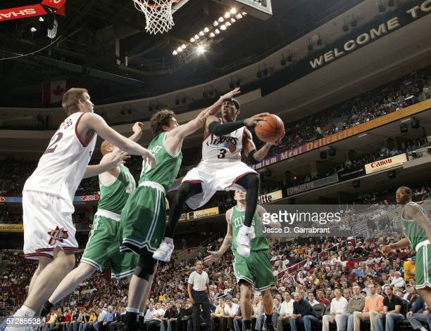 Allen Iverson of the Philadelphia 76ers shoots against Raef LaFrentz of the Boston Celtics on April 7 2006 at the Wachovia Center in Philadelphia...