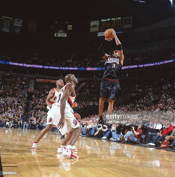 Allen Iverson of the Philadelphia 76ers shoots against Ruben Patterson of the Portland Trail Blazers during the game on December 28 2005 at the Rose...