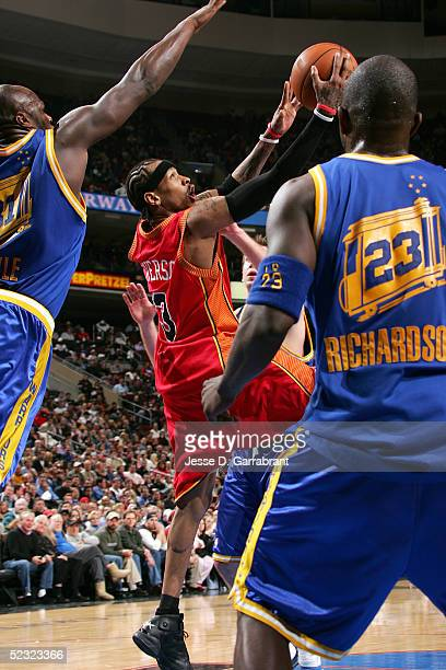 Allen Iverson of the Philadelphia 76ers shoots against the defense of the Golden State Warriors on March 8 2005 at the Wachovia Center in...