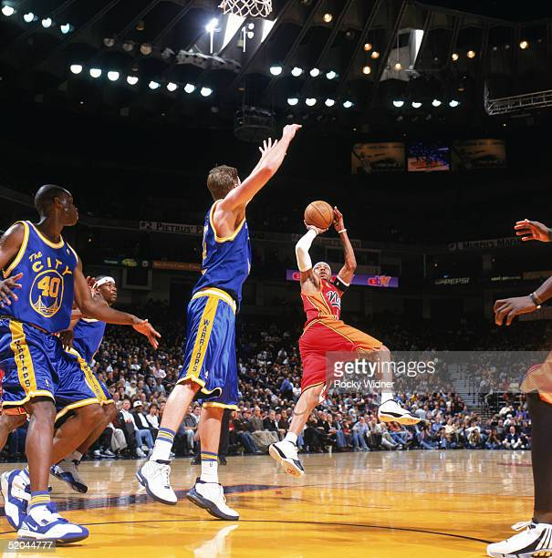 Allen Iverson of the Philadelphia 76ers shoots against Troy Murphy of the Golden State Warriors during a game at The Arena in Oakland on January 3...