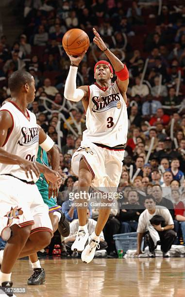 Allen Iverson of the Philadelphia 76ers shoots from backcourt during the NBA game against the New Orleans Hornets at First Union Center on November...