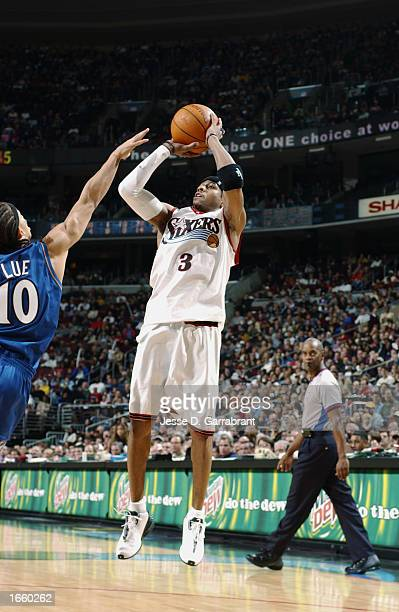 Allen Iverson of the Philadelphia 76ers shoots over Tyronn Lue of the Washington Wizards during the NBA game at First Union Center on November 17...