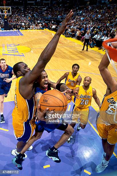 Allen Iverson of the Philadelphia 76ers shoots the ball against Shaquille O'Neal of the Los Angeles Lakers during a game on December 5 2000 at...