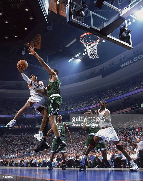 Allen Iverson of the Philadelphia 76ers shoots the ball over Tony Battie of the Boston Celtics during game 4 of the Eastern Conference quarterfinals...