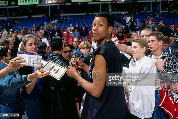 Allen Iverson of the Philadelphia 76ers signs autographs against the Sacramento Kings on January 5, 1997 at Arco Arena in Sacramento, California....