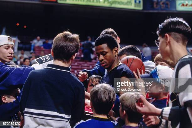 Allen Iverson of the Philadelphia 76ers signs autographs during a game played circa 1997 at the Spectrum in Philadelphia, Pennsylvania. NOTE TO USER:...