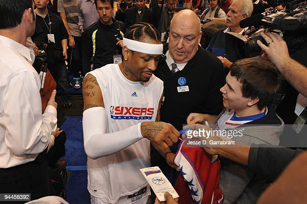 Allen Iverson of the Philadelphia 76ers signs autographs for fans before the game against the Denver Nuggets on December 7 2009 at the Wachovia...